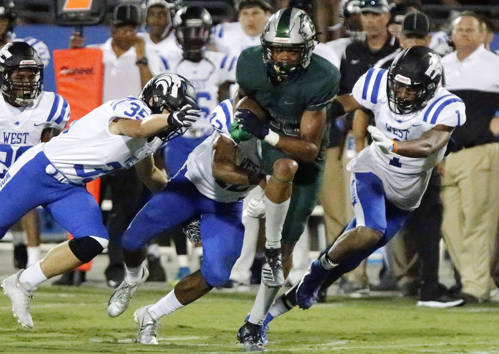 Reedy High School wide receiver Zion Washington (15) breaks free from a host of defenders to score a touchdown during the second half as Reedy High School hosted Plano West High School in a non-district football game at Toyota Stadium in Frisco on Thursday, August 28, 2019. (Stewart F. House/Special Contributor)
