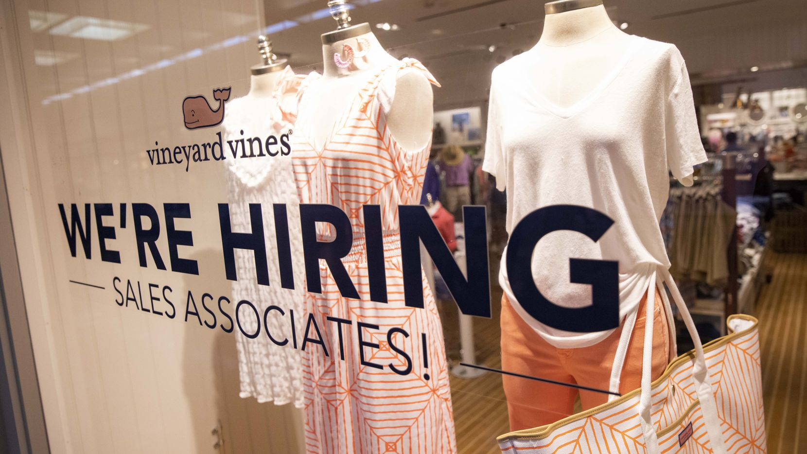 A hiring notice on the window at Vineyard Vines in Dallas' NorthPark Center .