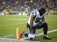 Carolina Panthers defensive tackle Dontari Poe kneels down on the field before an NFL football game between the Green Bay Packers and Carolina Panthers Monday, Nov. 11, 2019, in Green Bay, Wis.