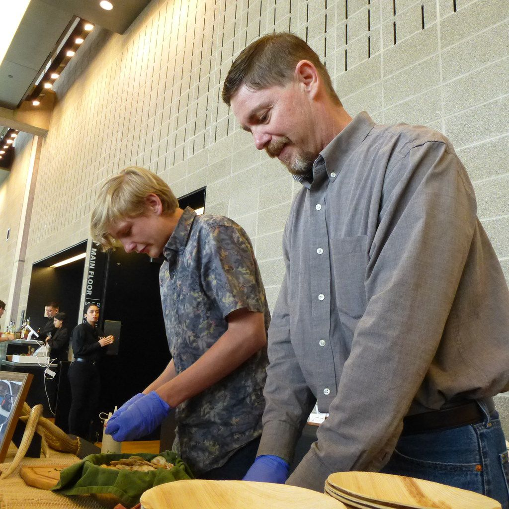 Chris Hughes from Broken Arrow Ranch prepares summer venison sausage samples for the Meet the Makers tasting at Moody Performance Hall, assisted by son Garrett, third-generation of the Ingram ranch family.