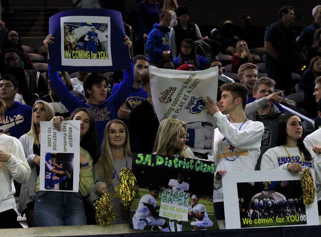 Frisco fans hold up signs during the first half of the team's game against South Oak Cliff in a high school football playoff game at the Star on Friday, November 22, 2019. (John F. Rhodes / Special Contributor)