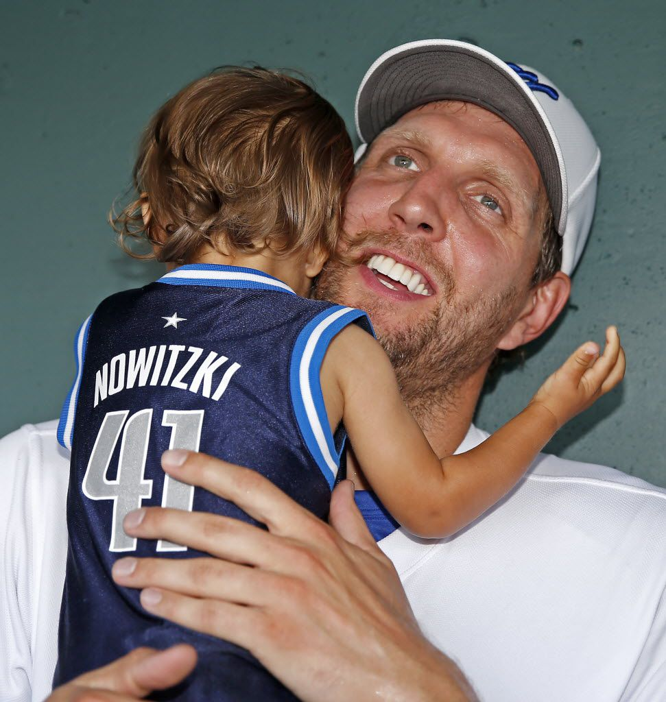 Dallas Mavericks Dirk Nowitzki hugs his 15-month-old son Max Nowitzki in the dugout during the Dirk Nowitzki's 2016 Heroes Celebrity Baseball Game at Dr Pepper Ballpark on Friday, June 10, 2016, in Frisco, Texas. (Jae S. Lee/The Dallas Morning News)
