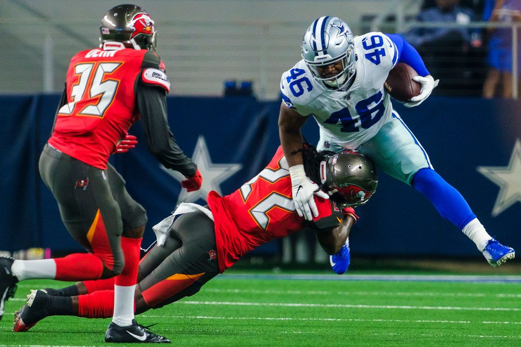 Dallas Cowboys running back Jordan Chunn (46) is brought down by Tampa Bay Buccaneers cornerback De'Vante Harris (22) during the first half of an NFL preseason football game at AT&T Stadium on Thursday, Aug. 29, 2019, in Arlington.