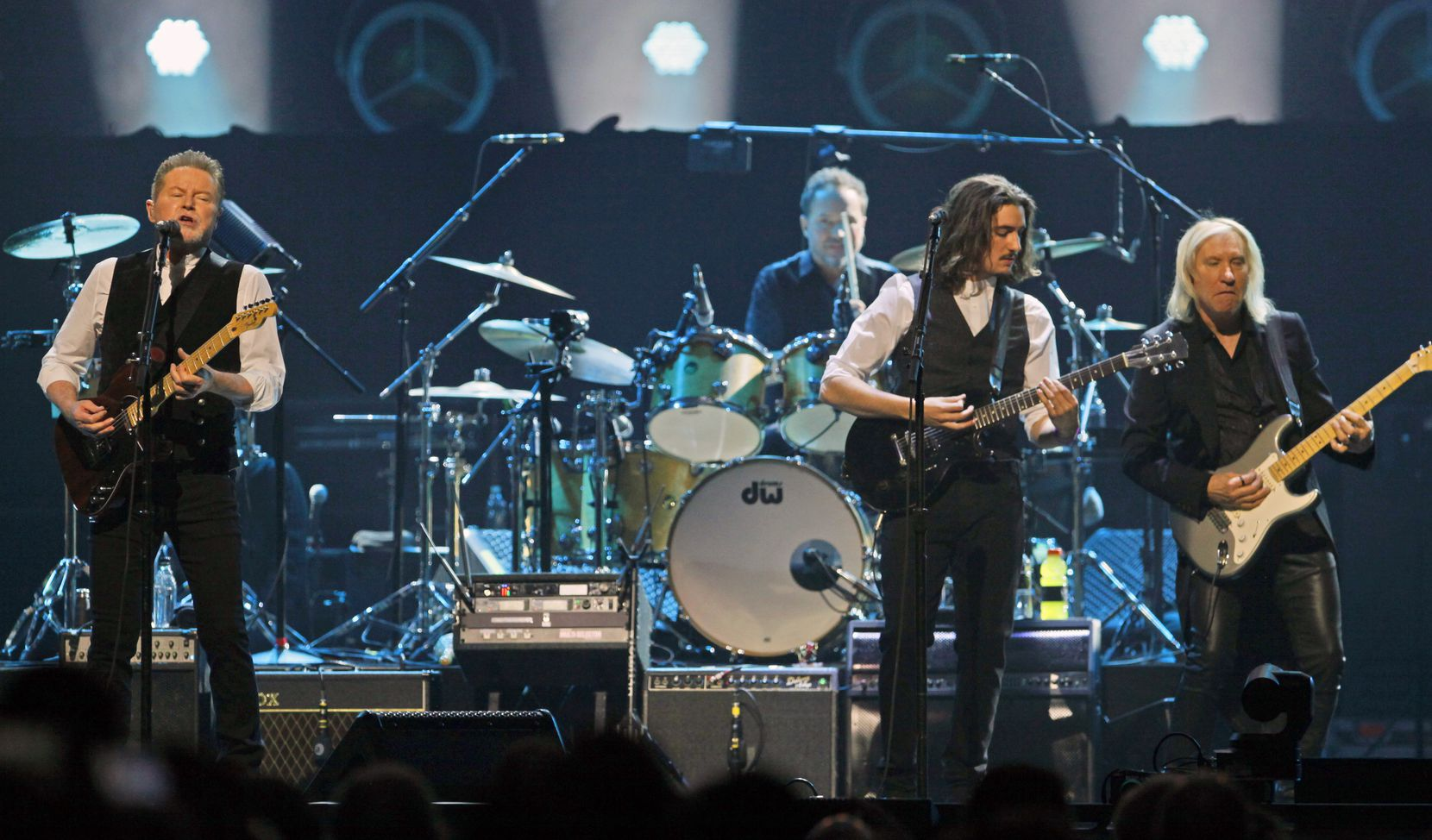 Don Henley (far left) performs with other members of the American rock band the Eagles at the American Airlines Center in Dallas, on  Feb. 29, 2020.