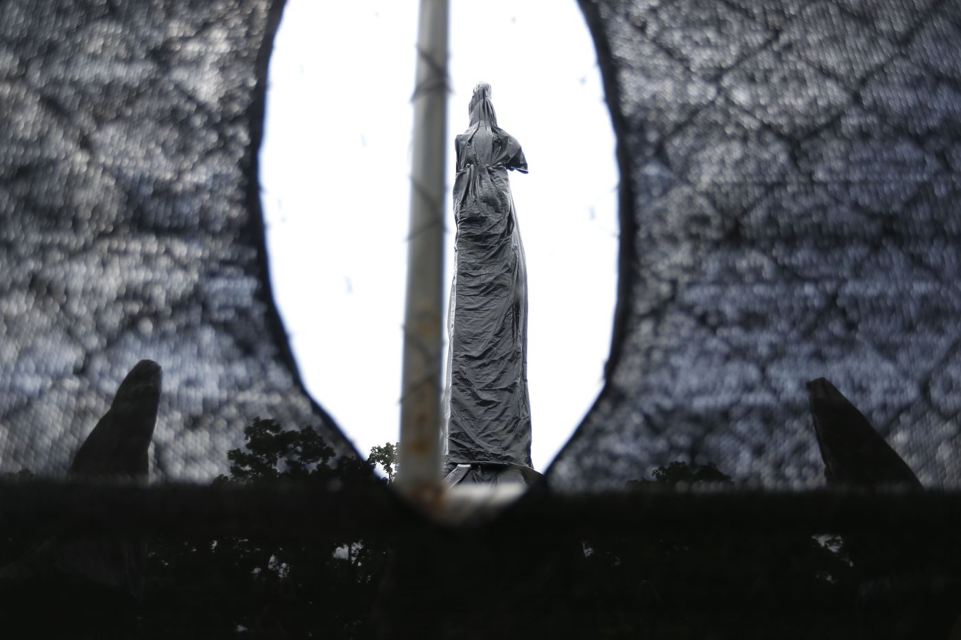 The statues and bases making up the Confederate War Memorial are wrapped in black plastic on Monday, May 20, 2019 in Dallas. The only things preventing the City of Dallas from removing the Confederate War Memorial from its location near City Hall and Dallas' convention center are a lawsuit and a request for a temporary restraining order filed in district court. (Michael Hamtil/The Dallas Morning News)