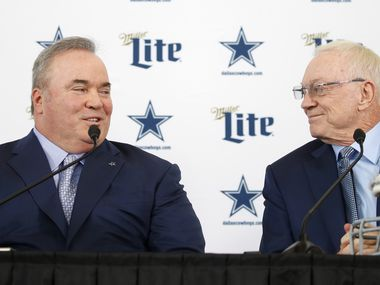 Dallas Cowboys new head coach Mike McCarthy and Dallas Cowboys owner and general manager Jerry Jones glance at each other during a press conference introducing the newly hired coach in the Ford Center at The Star in Frisco, on Wednesday, January 8, 2020.