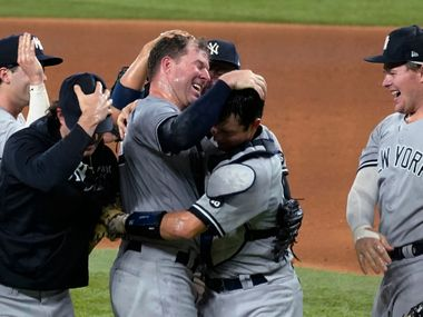 New York Yankees starting pitcher Corey Kluber, third from right, celebrates with catcher Kyle Higashioka, second from right, and the rest of the team after throwing a no-hitter against the Texas Rangers in a baseball game in Arlington, Texas, Wednesday, May 19, 2021.