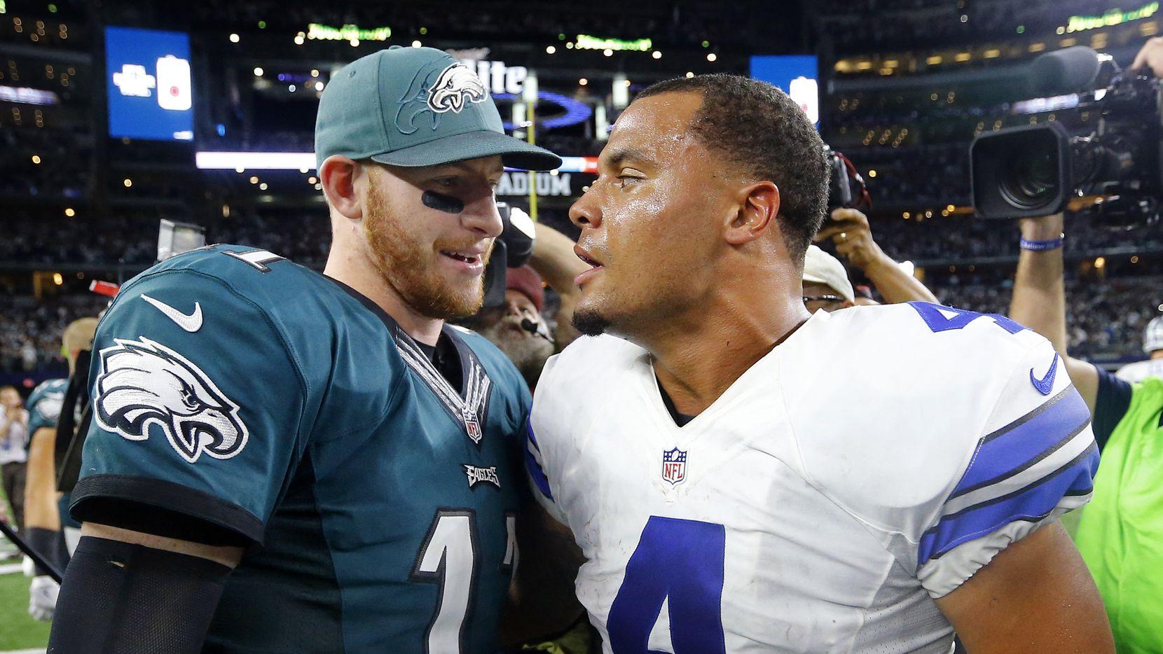 Philadelphia Eagles quarterback Carson Wentz (11) congratulates Dallas Cowboys quarterback Dak Prescott (4) after the 29-23 overtime win at AT&T Stadium in Arlington, Texas, Sunday, October 30, 2016. The Cowboys won, 29-23. (Tom Fox/The Dallas Morning News)