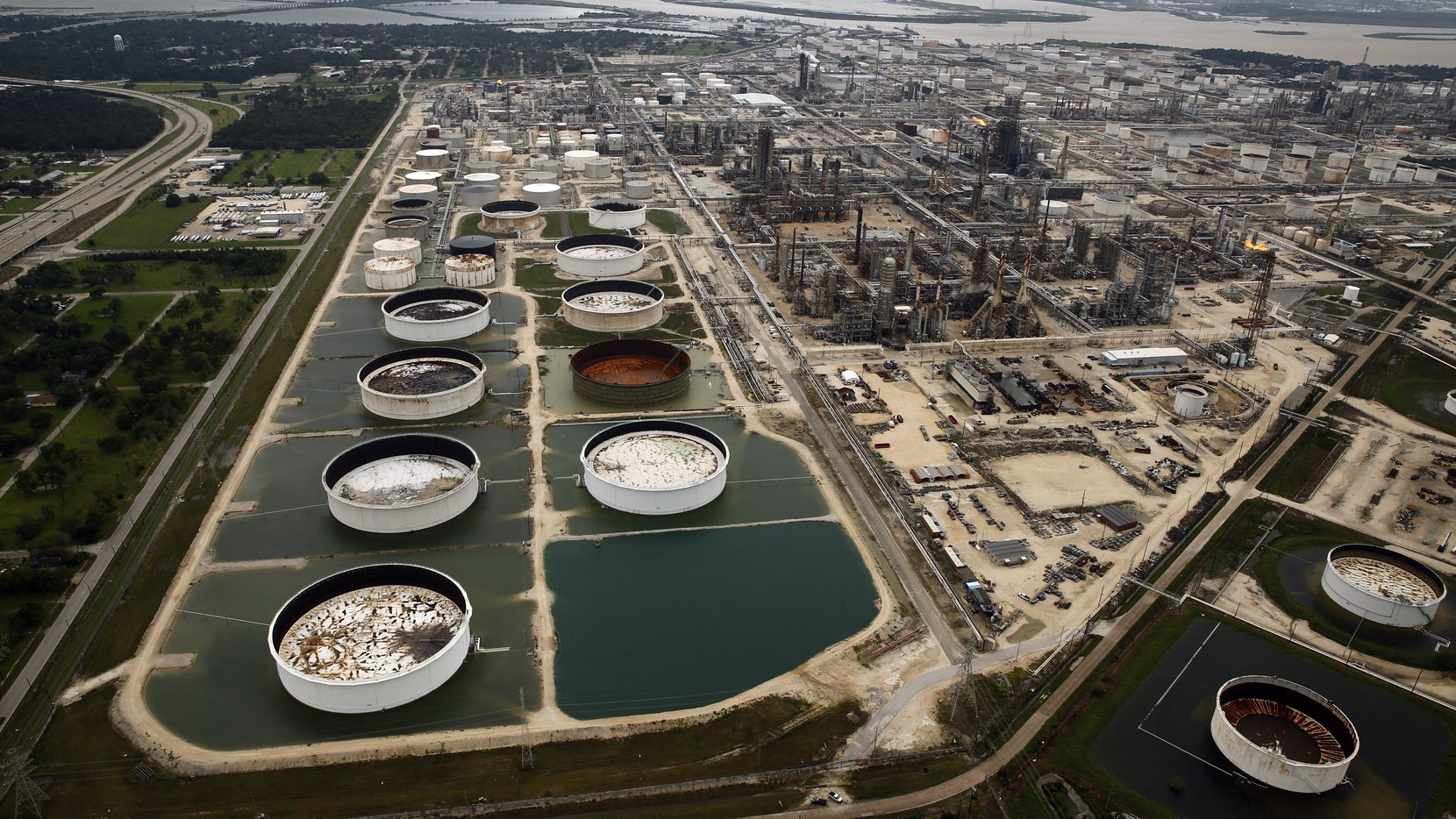 Large storage tanks situated in retention ponds were surrounded by rainwater left behind by Hurricane Harvey at ExxonMobil's refinery in Baytown, Texas, in 2017.
