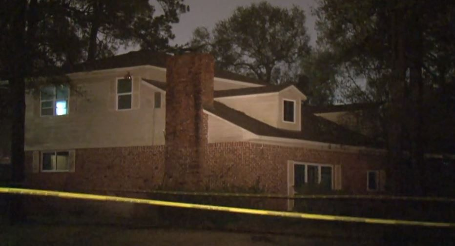 Police tape surrounds a home where someone sat on the roof and opened fire on a car full of people who had earlier been involved in a fight. Two men were killed and the suspects remain at large.