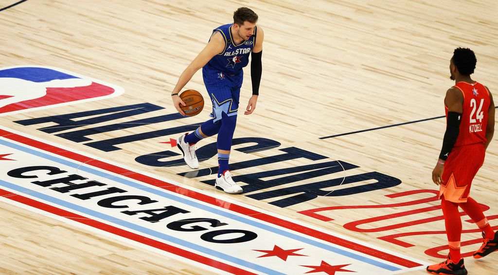 Team LeBron's Luka Doncic (2) dribbles up the court as Team Giannis's Donovan Mitchell (24) during the first half of play in the NBA All-Star 2020 game at United Center in Chicago on Sunday, February 16, 2020. (Vernon Bryant/The Dallas Morning News)