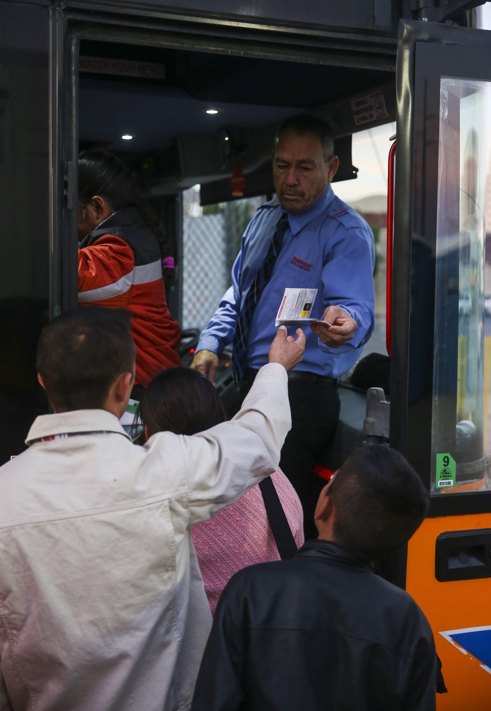 Migrant asylum seekers Carlos Joaquin Salinas, 29, of Santa Rosa, Guatamala, and his son Fernando Salinas, 10, board at the Tornado Bus station in El Paso, Texas, on Saturday, March 30, 2019 to travel to Arlington, Texas.