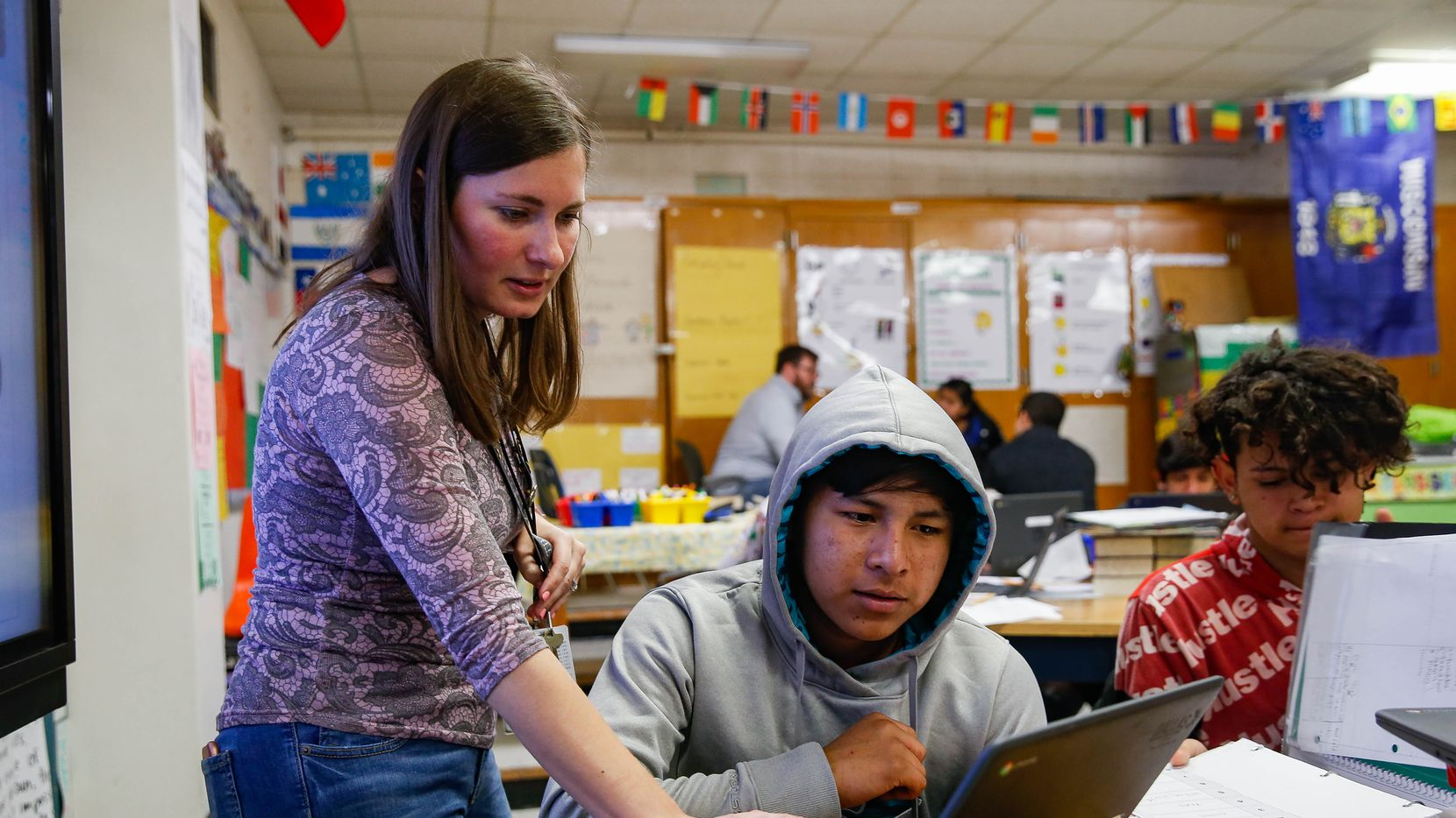 Teacher Autumn Slosser helps freshman Maynor Caal, who is learning English as a third language, through his second language, Spanish. Maynor is one of about 30 students at Thomas Jefferson High School who speak Q'eqchi' (Kek-chee), an indigenous Mayan language, as their native language.