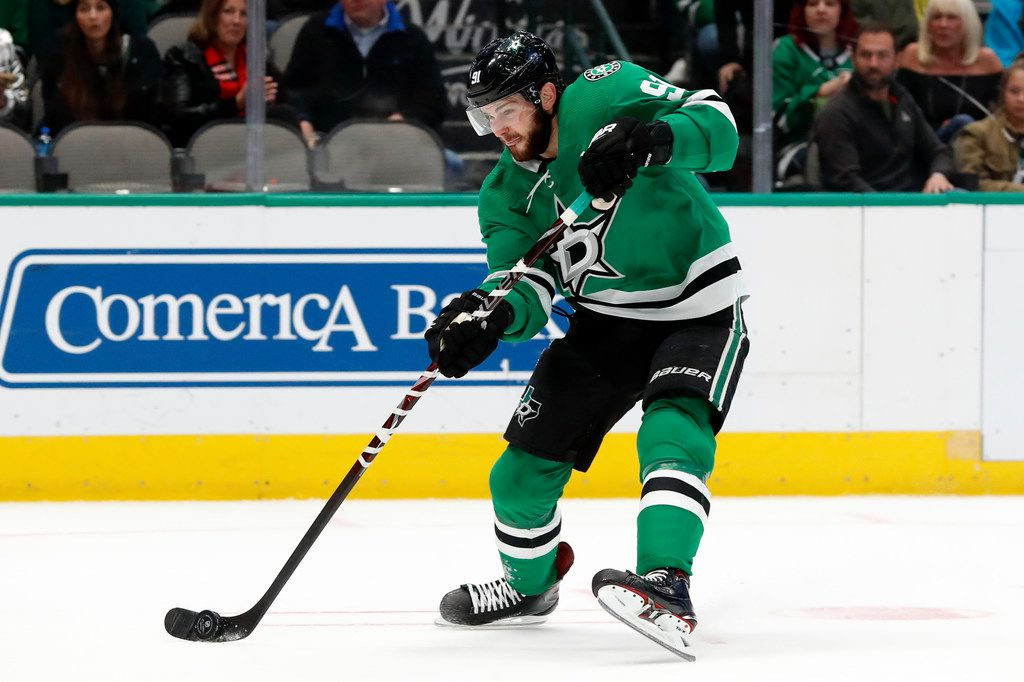 Dallas Stars center Tyler Seguin (91) takes a shot at the net in the first period of an NHL hockey game against the Chicago Blackhawks in Dallas, Saturday, Nov. 23, 2019. (AP Photo/Tony Gutierrez)