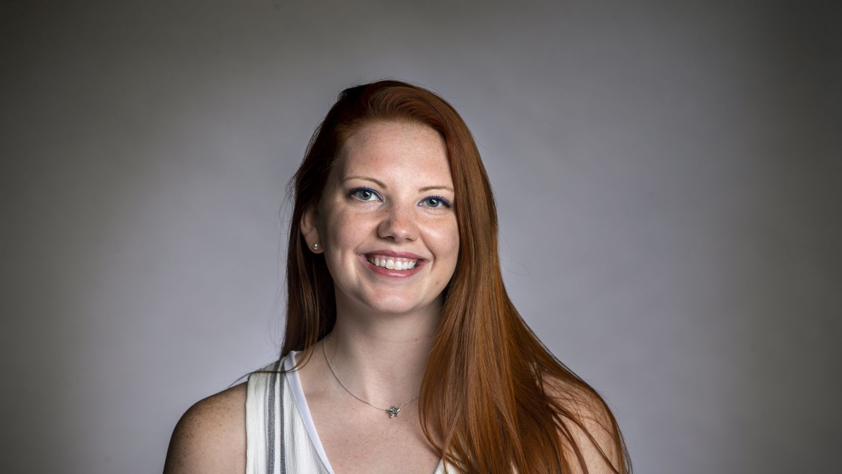 Sports intern Tess DeMeyer poses for a portrait at The Dallas Morning News studio in Dallas on Monday, Aug. 24, 2020.