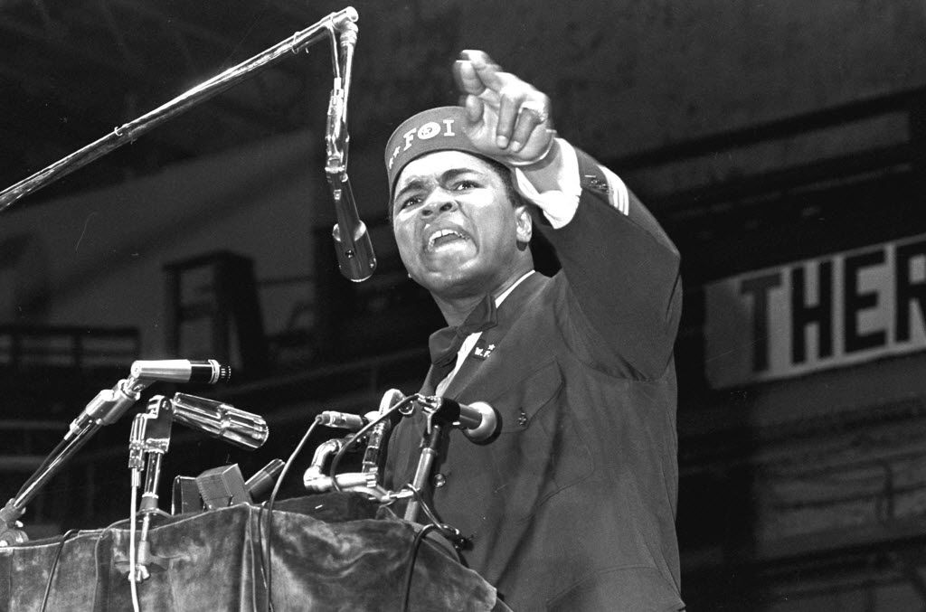 """FILE - In this Feb. 25, 1968 file photo, former heavyweight boxing champion Muhammad Ali addresses a gathering at a Black Muslim convention in Chicago. A new documentary about Ali, """"Trials of Muhammad Ali,"""" gives a glimpse of how many Americans felt about him during a tumultuous time in the country's history. (AP Photo/File)"""