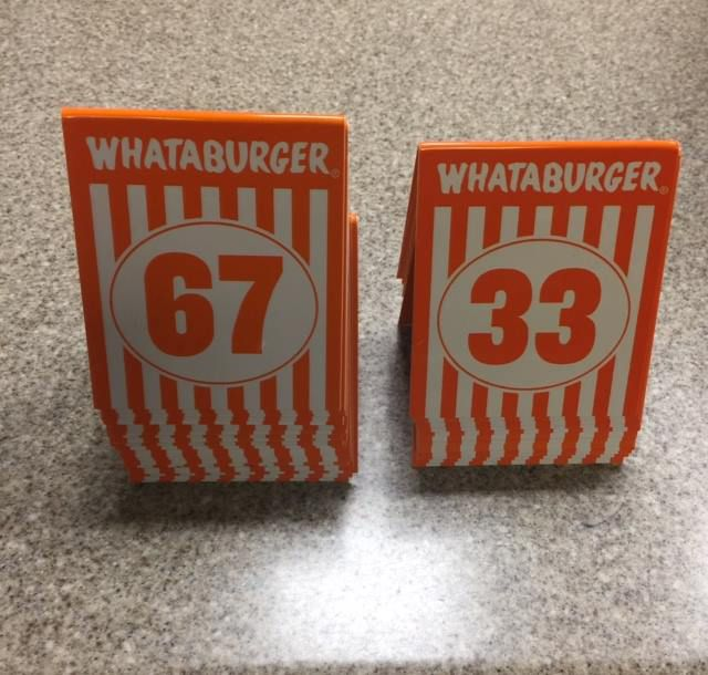 Stack of Whataburger numbers recovered by police, left, and those remaining in the restaurant.