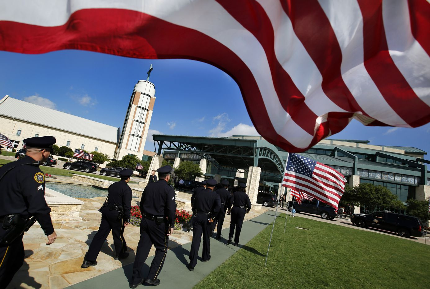 Police officers arrive to Prestonwood Baptist Church in Plano for the funeral service of fallen Dallas police officer Lorne Ahrens, Wednesday, July 12, 2016.
