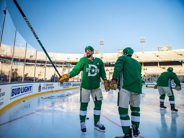 Dallas Stars left wing Jamie Benn, left, taps his stick against the glass during a practice leading up to the Winter Classic match against the Nashville Predators at the Cotton Bowl in Fair Park, Tuesday, December 31, 2019. (Brandon Wade/Special Contributor)
