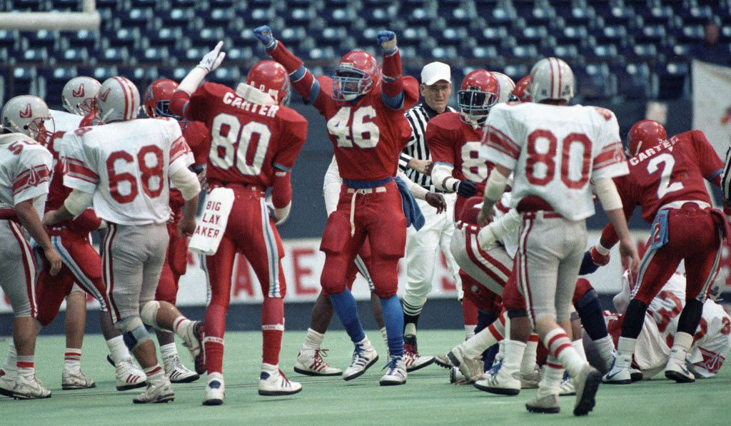 12-17-1988. Derric Evans #80, and Jessie Armstead, #46  of Carter high school, celebrate during the 5A state high school championship game at Texas Stadium against Converse Judson high school.