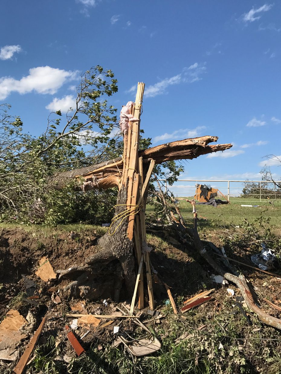 """The chaos from the storm left this cross-like piece made from a fallen tree, two-by-fours and an electrical cord. """"That is the only reason why we are alive today,"""" Scott said. """"There's no way a tornado just did that."""" (Amanda Scott)"""