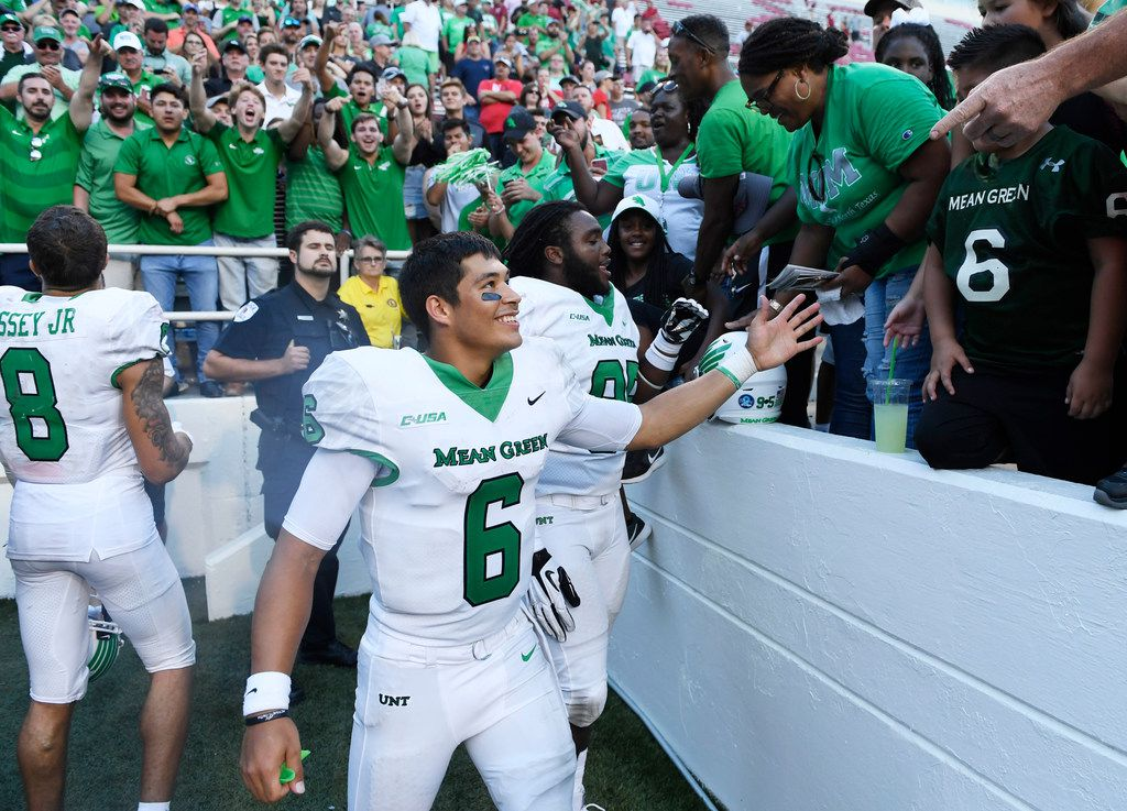 North Texas quarterback Mason Fine celebrates with fans after defeating Arkansas 44-17 after an NCAA college football game Saturday, Sept. 15, 2018, in Fayetteville, Ark. (AP Photo/Michael Woods)