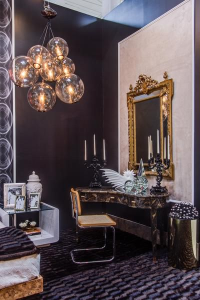 Tompkins Lloyd InteriorsThe team's Dwell With Dignity space is a luxe bedroom that plays up a glamorous '70s vibe. Big gold mirrors are trendy today, too.