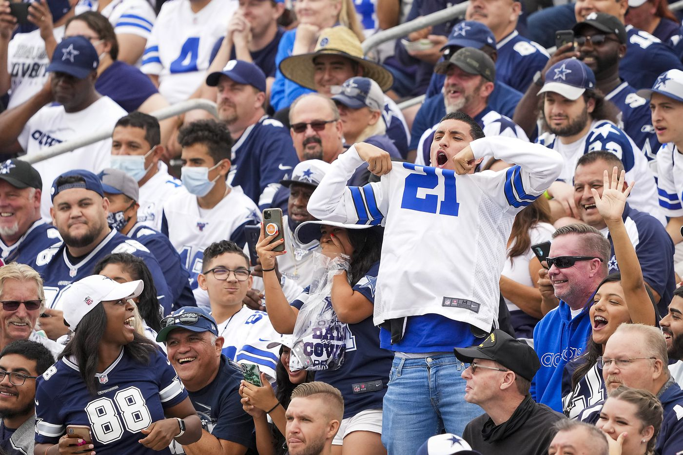 A fan yells his support for Dallas Cowboys running back Ezekiel Elliott during a practice at training camp on Saturday, July 24, 2021, in Oxnard, Calif.