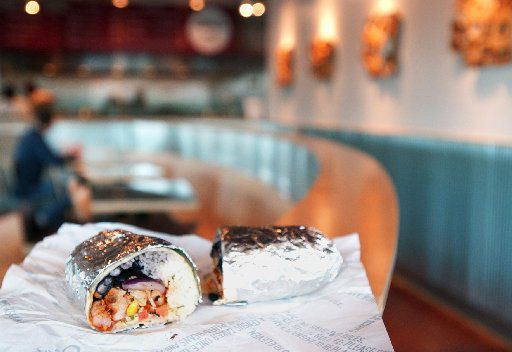 Mobile app customers and third-party delivery drivers can pull up in the Chipotlane and quickly get their to-go food.