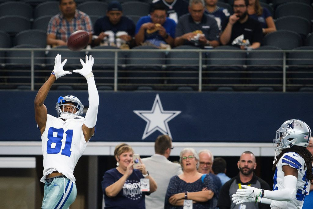 Dallas Cowboys wide receiver Jon'Vea Johnson (81) catches a pass as the teams warm up before an NFL preseason football game against the Tampa Bay Buccaneers at AT&T Stadium on Thursday, Aug. 29, 2019, in Arlington.