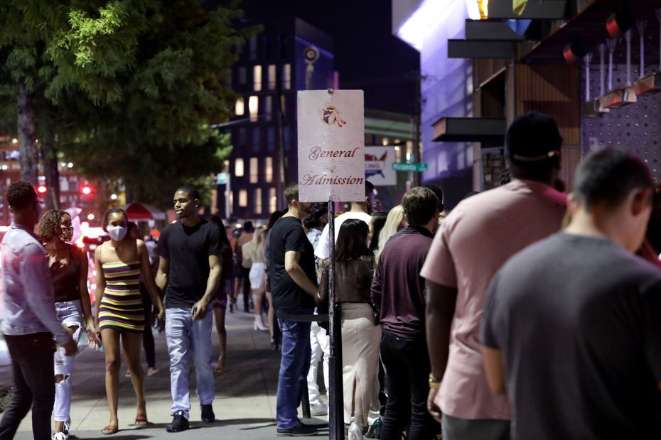 Guests wait in line outside of Bottled Blonde in Dallas on Sept. 11, 2020.