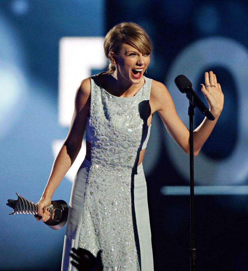 Taylor Swift reacts after receiving her Milestone Award during the 2015 Academy of Country Music Awards Sunday, April 19, 2015 at AT&T Stadium in Arlington, Texas.