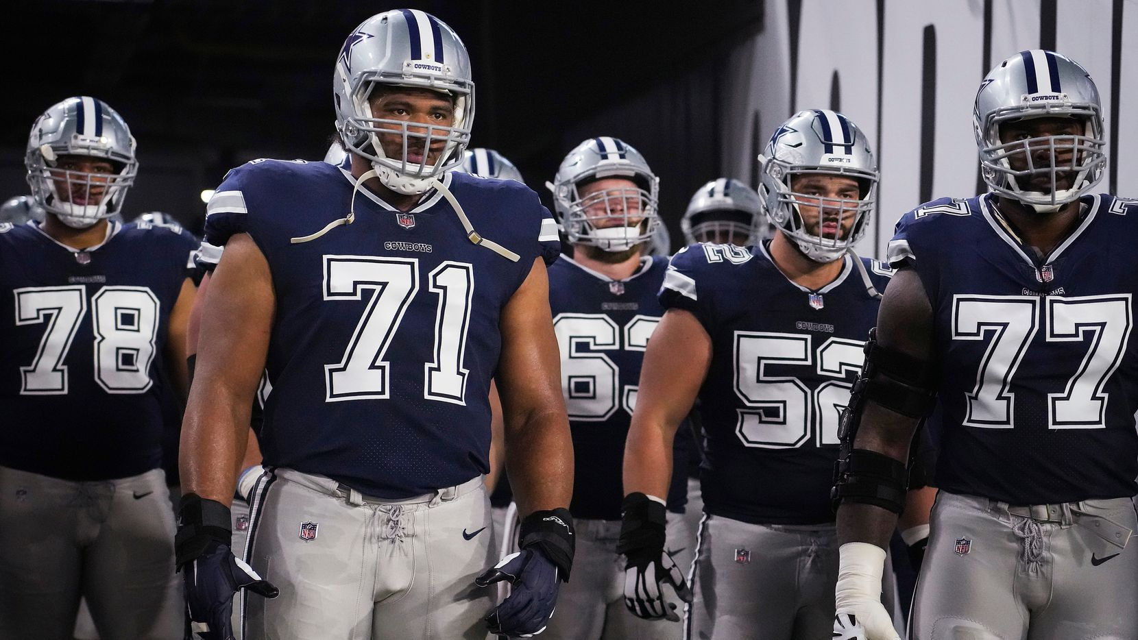 Dallas Cowboys offensive tackle La'el Collins (71) waits to take the field with offensive tackle Terence Steele (78), center Tyler Biadasz (63), guard Connor Williams (52) and offensive tackle Tyron Smith (77) before an NFL football game against the Tampa Bay Buccaneers at Raymond James Stadium on Thursday, Sept. 9, 2021, in Tampa, Fla. (Smiley N. Pool/The Dallas Morning News)