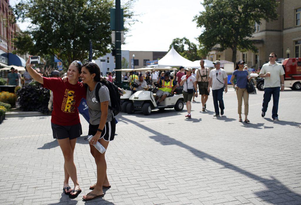 Rachel Felts (left) and Sarah Thomas take a selfie at the McKinney Oktoberfest in historic downtown McKinney.