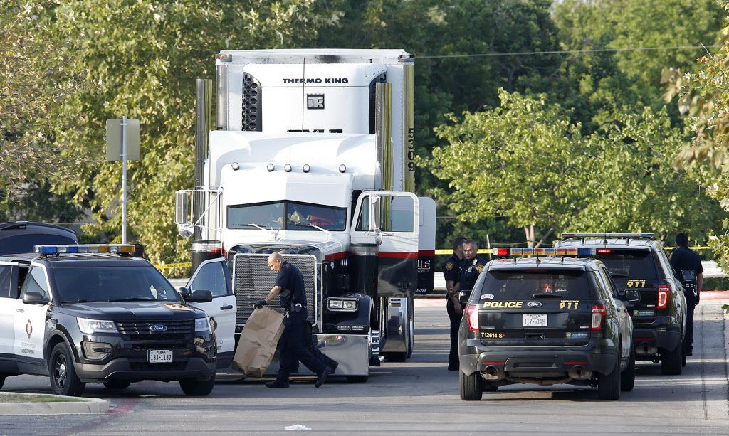 Law enforcement found eight migrants dead in the back of a tractor-trailer parked behind a Walmart store in San Antonio on Sunday. Two others have died since then.
