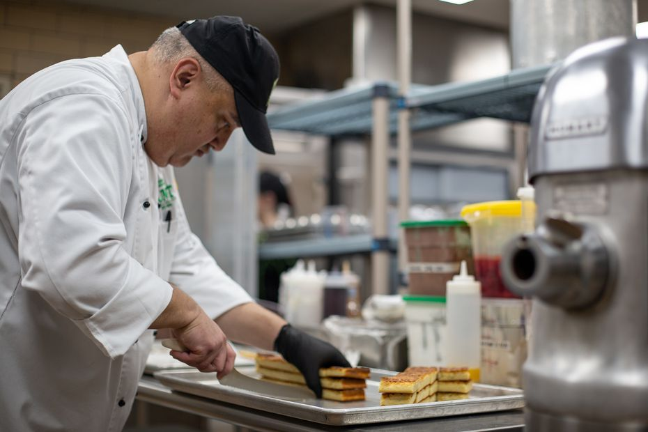 Senior Executive Chef Rudy Vasquez slices rosemary focaccia bread  at Kitchen West at the University of North Texas in Denton. Many people with a gluten intolerance or allergy struggle to eat bread, but this kitchen makes focaccia in-house that's safe for them to eat.