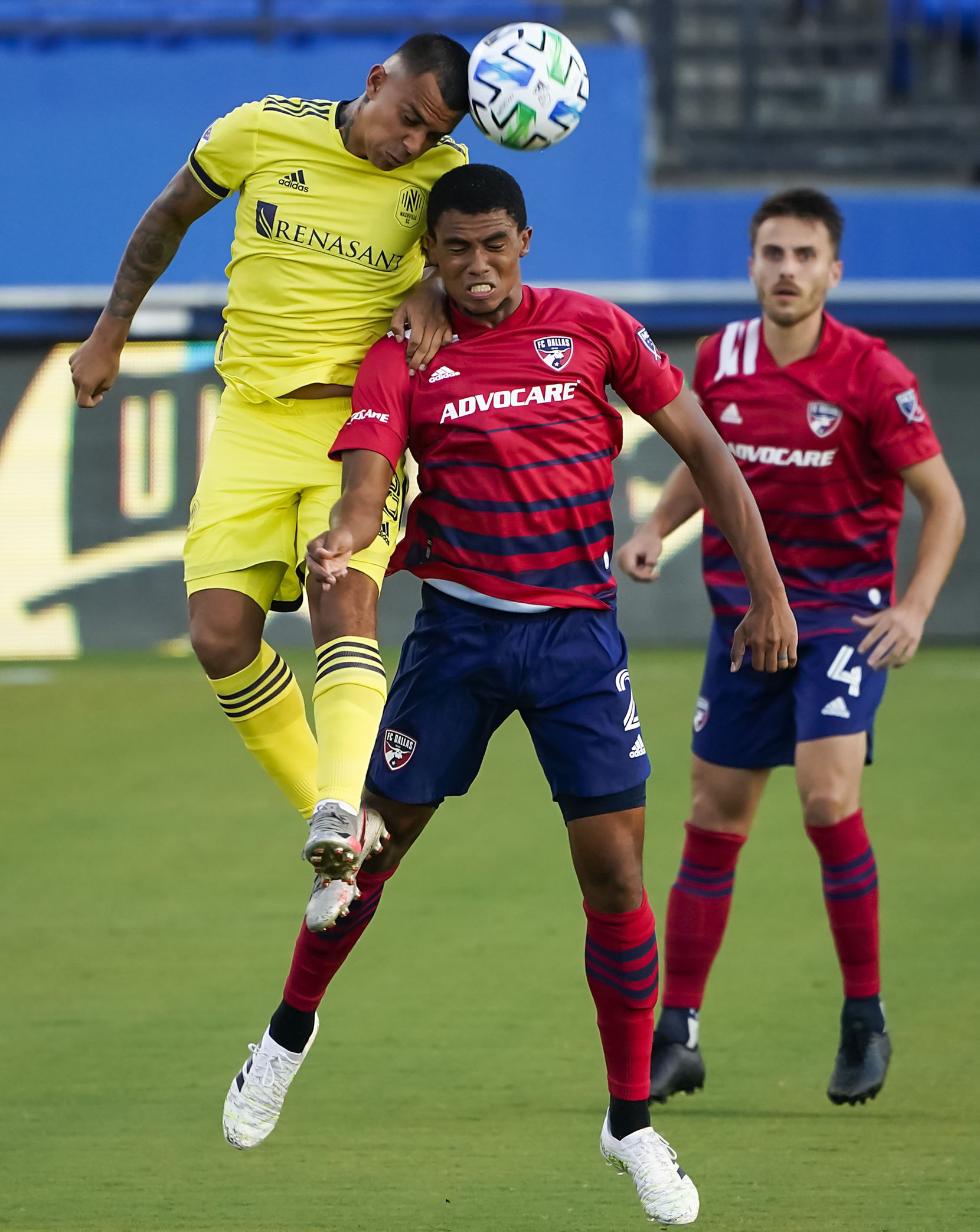 FC Dallas defender Reggie Cannon (2) fights for a header against Nashville SC midfielder Randall Leal (8) during the first half of an MLS soccer game at Toyota Stadium on Wednesday, Aug. 12, 2020, in Frisco, Texas. (Smiley N. Pool/The Dallas Morning News)
