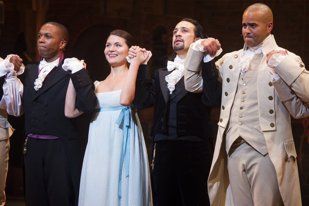 """Leslie Odom Jr., from left, Phillipa Soo, Lin-Manuel Miranda and Christopher Jackson appear at the curtain call following the opening night performance of """"Hamilton"""" at the Richard Rodgers Theatre in New York."""
