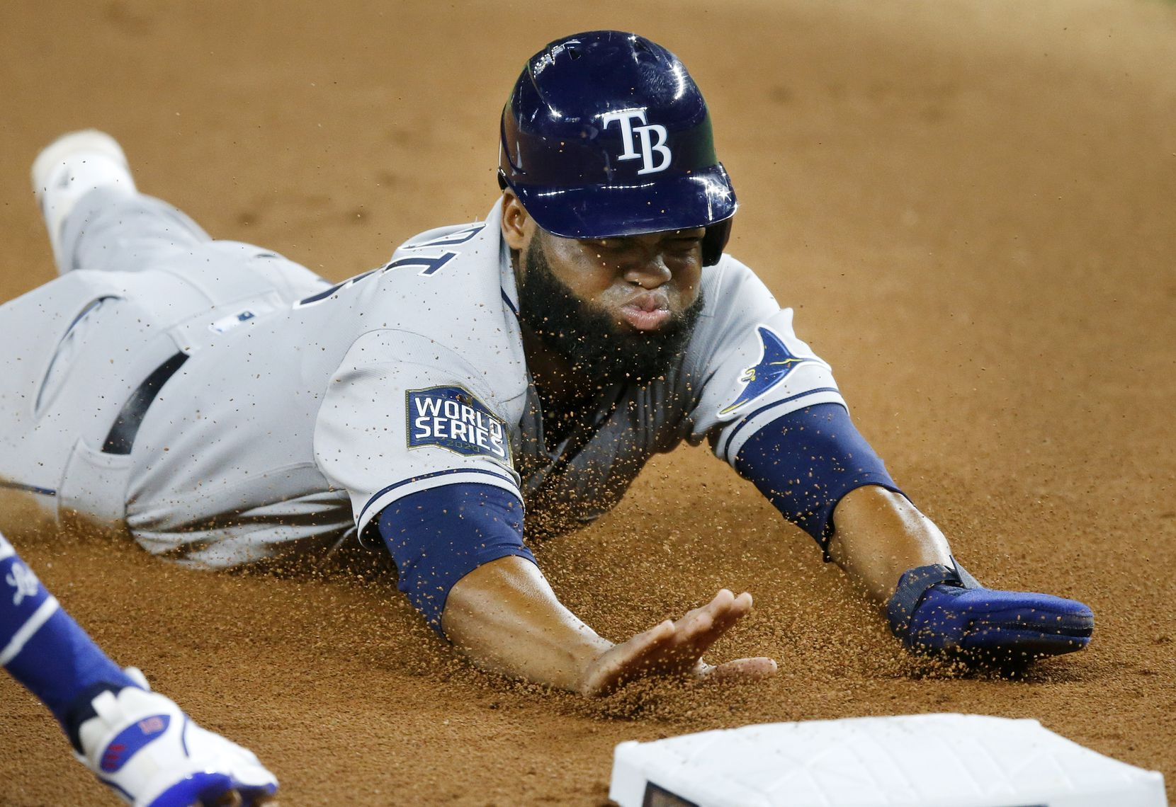 Tampa Bay Rays Manuel Margot (13) slides safely into third base on a fly ball by Joey Wendle (18) during the second inning against the Los Angeles Dodgers in Game 2 of the World Series at Globe Life Field in Arlington, Wednesday, October 21, 2020. (Tom Fox/The Dallas Morning News)
