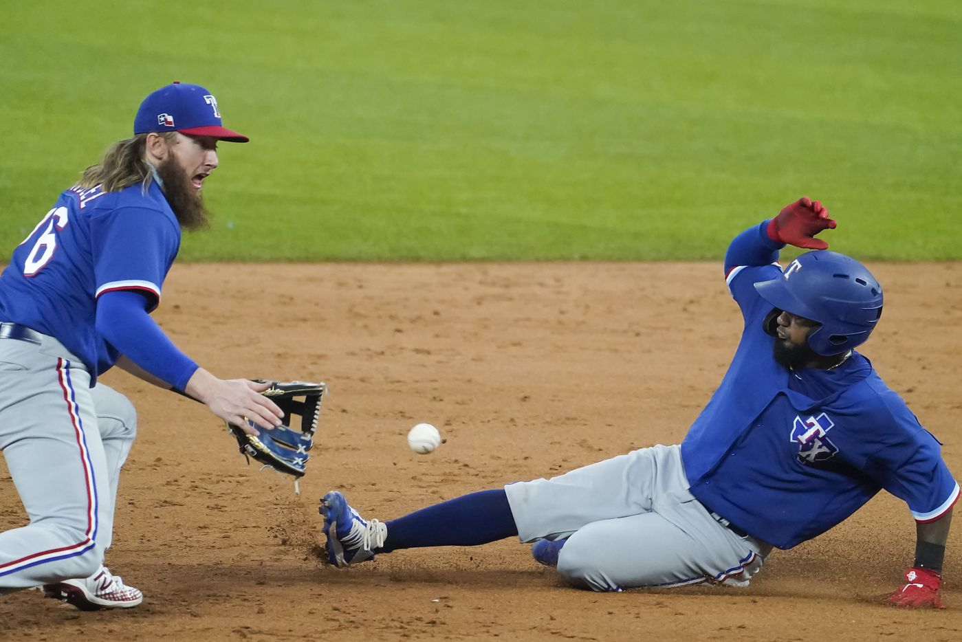 Texas Rangers infielder Davis Wendzel takes the throw as Yonny Hernandez attempts to steal second base during a game between players at the team's alternate training site at Globe Life Field on Saturday, Sept. 19, 2020.