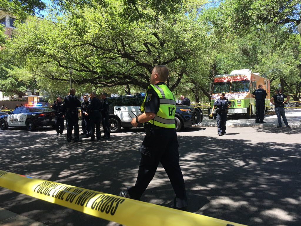 Emergency personal work outside the scene where a student was fatally stabbed and three were injured on the Univeristy of Texas campus Monday. (Tamir Kalifa/Austin American-Statesman)