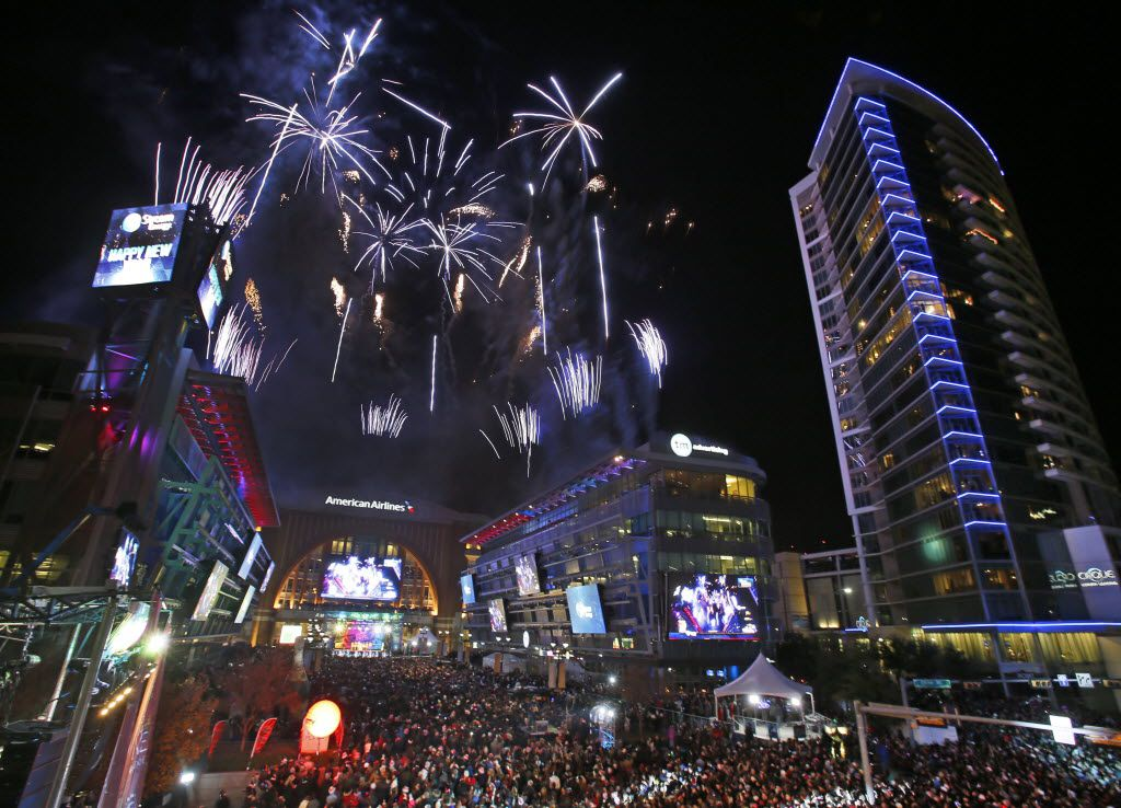 The fireworks fill the sky as the calendar turns over to 2014 at the Big D New Year's Eve 2014 celebration at Victory Plaza in Dallas on Tuesday, December 31, 2013.