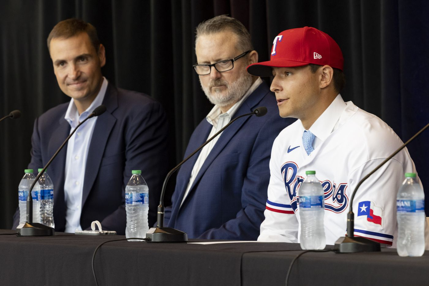(From left) Chris Young, Texas Rangers Executive Vice President and General Manager, Kip Fagg, Rangers Senior Director of Amateur Scouting, listen to Jack Leiter from Vanderbilt University speak during a press conference announcing his signing on Tuesday, July 27, 2021, at Globe Life Field in Arlington. Leiter was the club's 2021 MLB Draft first round selection and the draft's second overall pick.