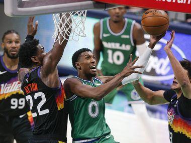 Dallas Mavericks guard Josh Richardson (0) attempts a layup as Phoenix Suns forwards Deandre Ayton (22) and Cameron Johnson (23) defend during the second half of an NBA basketball game in Dallas, Saturday, January 30, 2021. Phoenix won 111-105. (Brandon Wade/Special Contributor)