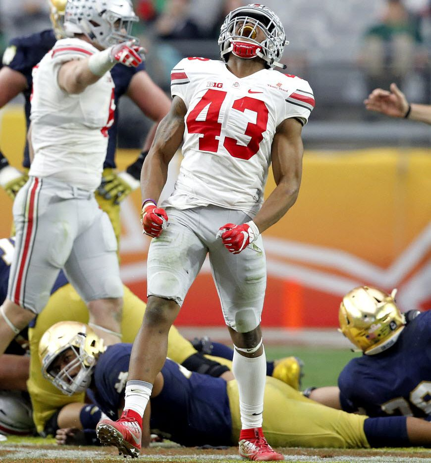 Ohio State linebacker Darron Lee (43) celebrates his sack against Notre Dame during the second half of the Fiesta Bowl NCAA College football game, Friday, Jan. 1, 2016, in Glendale, Ariz. Ohio State won 44-28. (AP Photo/Ross D. Franklin)