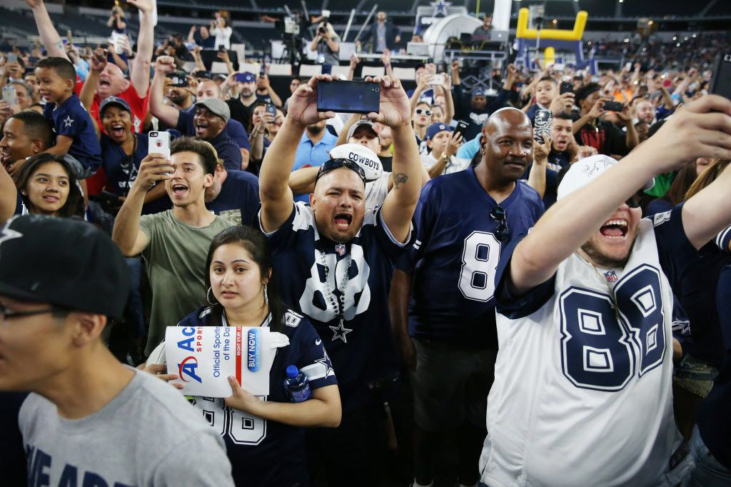 Mario Flores (center), of Dallas, reacts with other fans during a watch party as the Dallas Cowboys pick running back Ezekiel Elliott, of Ohio State, in the first round of the 2016 NFL Draft at AT&T Stadium in Arlington, Texas Thursday April 28, 2016. (Andy Jacobsohn/The Dallas Morning News)