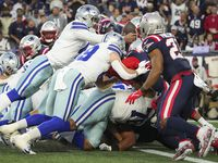 Dallas Cowboys quarterback Dak Prescott (4) loses the ball as he tries to dive into the end zone on a 4th-and-1 play during the second quarter of an NFL football game against the New England Patriots on Sunday, Oct. 17, 2021, in Foxborough, Mass.