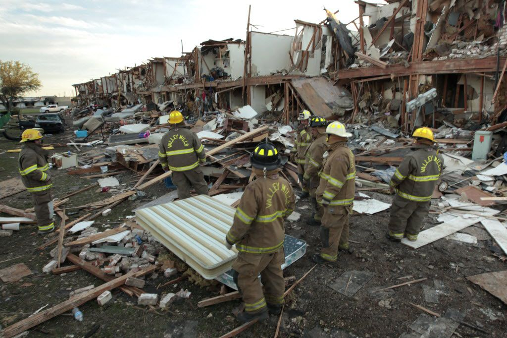 Members of the Valley Mills Fire Department walked among the remains of an apartment complex next to the fertilizer plant in West that exploded April 18, 2013.