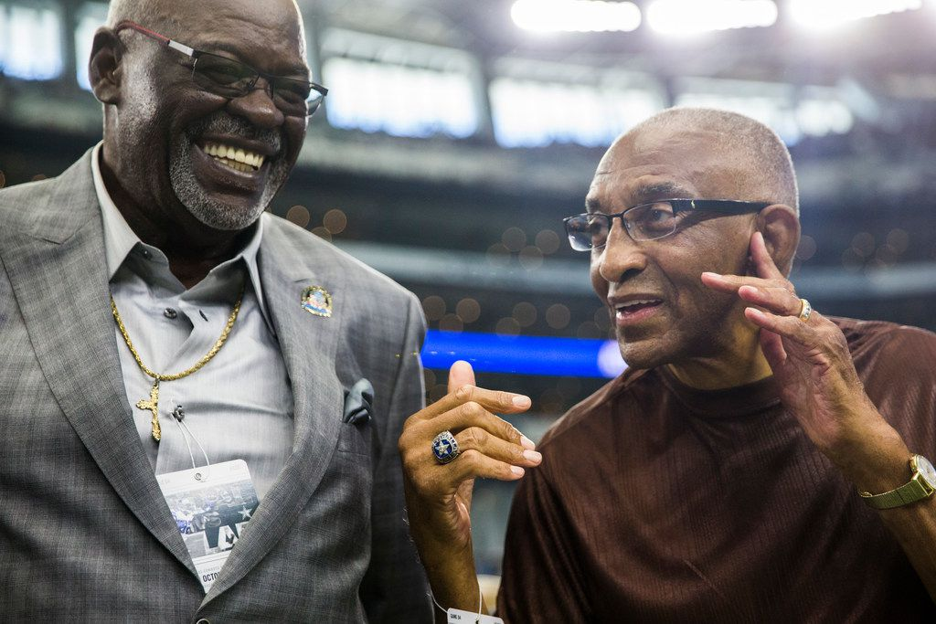 Former Dallas Cowboys players Rayfield Wright (left) and Pettis Norman talk on the sideline before an NFL football game between the Los Angeles Rams and the Dallas Cowboys on Sunday, October 1, 2017 at AT&T Stadium in Arlington, Texas. (Ashley Landis/The Dallas Morning News)