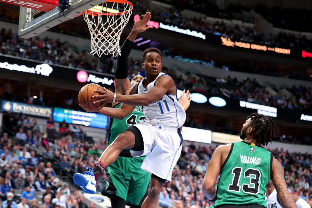 DALLAS, TX - FEBRUARY 13:  Yogi Ferrell #11 of the Dallas Mavericks passes the ball against Al Horford #42 of the Boston Celtics and James Young #13 of the Boston Celtics in the second half at American Airlines Center on February 13, 2017 in Dallas, Texas. NOTE TO USER: User expressly acknowledges and agrees that, by downloading and or using this photograph, User is consenting to the terms and conditions of the Getty Images License Agreement.  (Photo by Tom Pennington/Getty Images)